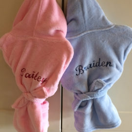blue and pink kids robes